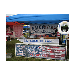 Vinyl banner and stand  by Custom Graphics and Signs