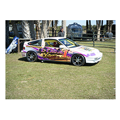 Full car wrap designed by Custom Graphics and Signs