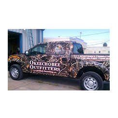 Full truck wrap designed by Custom Graphics and Signs