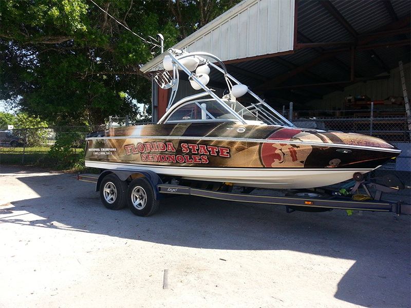 Ski boat wrap designed by custom graphics and signs