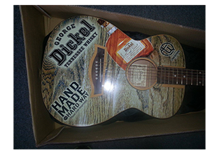 Guitar wrap designed by Custom Graphics and Signs