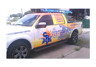 Full pickup truck wrap  designed by Custom Graphics and Signs