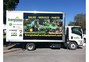 Full box truck wrap designed by Custom Graphics and Signs