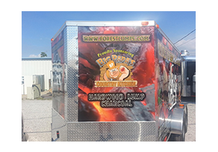 Trailer wrap front view designed by Custom Graphics and Signs