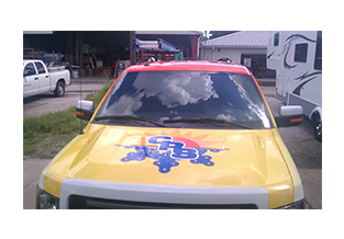 Hood view of full pickup truck wrap  designed by Custom Graphics and Signs