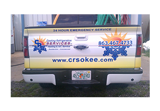 Tailgateview of full pickup truck wrap  designed by Custom Graphics and Signs