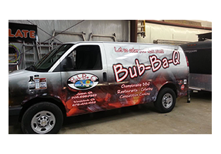 Full van wrap designed by Custom Graphics and Signs